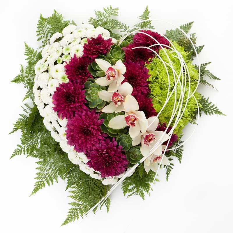 Spedire composizione lutto con orchidee