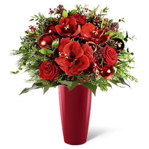 Spedire fiori di natale rossi con vaso rosso