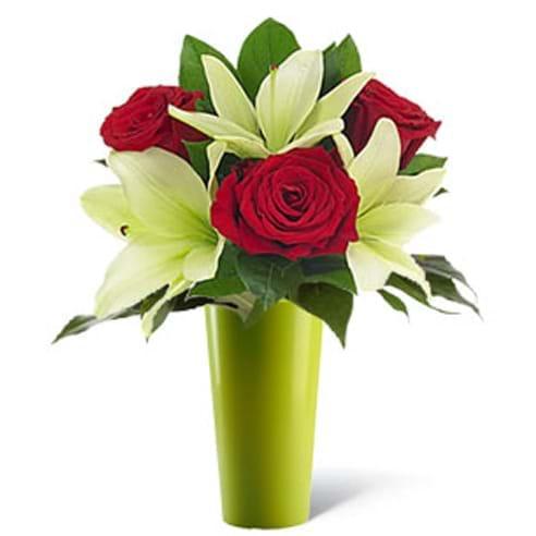 Spedire tre rose rosse e lilium in vaso verde
